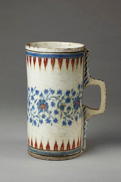 Ceramic mug - vessel - tankard. Made of cobalt, red painted and glazed ceramic, pottery. School/style: Iznik Culture/period: Ottoman dynasty. Date: 16thC. British Museum