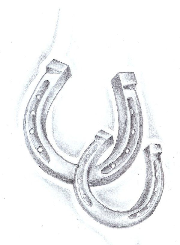 Horseshoe tattoo sketch with pretties around it. :) or the big one simply by itself with a quote tangled in somehow