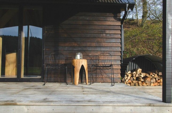 Wonderful, easy idea for firewood storage. And the table is awesome!  Out of the Valley rental cabin in Devon, England | Gardenista