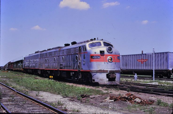 https://flic.kr/p/SnxmQ9 | Burlington  Northern E-8's at Brighton Park IL May 1974 | with intercity passenger long gone and Amtrak many railroads had extra E-units and F-units that were used on Frt service .i'm here at Brighton Park IL on the Pan Handel line with a BN transfer train with auto racks heading south