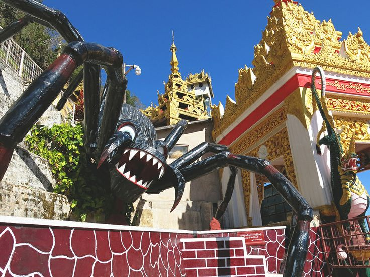 A giant spider guards the mouth of the entrance to the cave of a thousand Buddhas in Pindaya. www.odysseymyanmar.com