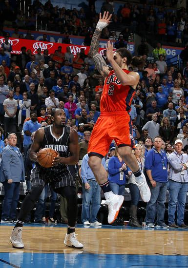 Orlando's Serge Ibaka, left, prepares to launch the game-winning shot as Oklahoma City's Steven Adams defends during Sunday night's NBA game at Chesapeake Energy Arena. [PHOTO BY SARAH PHIPPS, THE OKLAHOMAN]
