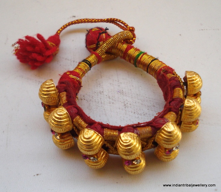 India   A vintage bracelet from Rajasthan.  Seven 20k gold beads adorned with glass stones are strong on traditional yarn with an end loop and thread knot.  The gold beads are filled with wax.