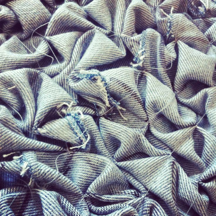 Sewing strips of denim together to create enough fabric meterage for my smocked panel. #smocking #denim #upcycle