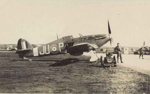 """Sgt Otakar """"Ota"""" Hrubý stands by Hurricane Mk I JU-P at RAF Dyce in 1940. On a combat practice flight 7 days after joining No 111 Squadron RAF at RAF Drem on 9 October, the 26-year-old Czech crashed on landing in a field at Turriff. Escaping slightly injured, he reported back to flying duties 9 days later."""