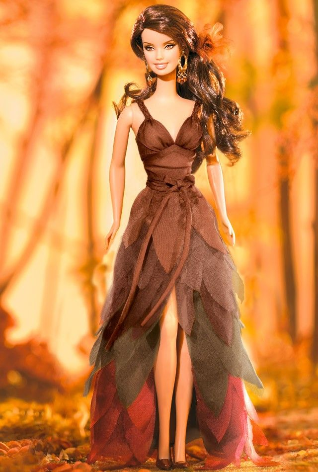 I am such a Barbie nerd... would love to have a barbie display case of amazing barbies like this one... plus I wouldn't mind owning her dres... looooove fallllll!   I Dream of Autumn™ Barbie® Doll | Barbie Collector