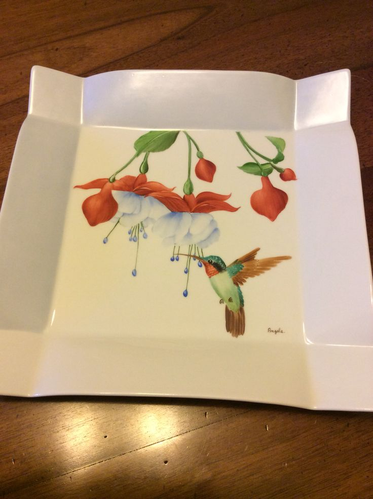 Hummingbird and fucsias by Angela Davies