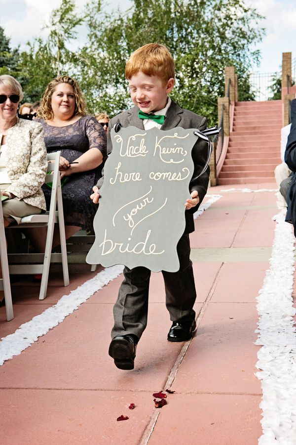 Adorable ring bearer sign 'Here comes your bride'