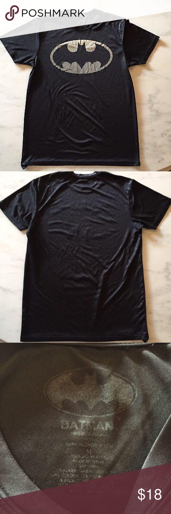 "Batman T-shirt Sport Unisex Gotham City Black Batman Unisex t-shirt.  This fabric is similar to spandex/gore-tex. I cannot say for certain.  • Size Medium.  • Measurements:  • Armpit to armpit 20"".  • Shoulder to shoulder: 17"".  • Length from shoulder to bottom: 27 1/2"".  • Fantastic condition! Batman Shirts"