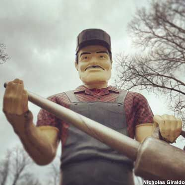 Cassopolis, Michigan: Casey Jones: Private Muffler Man -   Edward Lowe made his fortune in kitty litter. He bought a Muffler Man, customized him as Casey Jones the railroad engineer, and set him up on his estate. You can see him by appt.