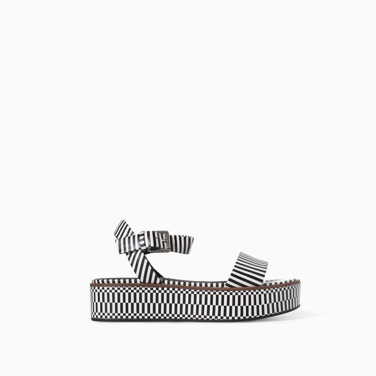 STRIPED BLOCK WEDGE - Shoes - TRF - SALE | ZARA Canada Ref. 3523/301 79.90 CAD UPPER 100% POLYURETHANE LINING 100% POLYURETHANE SOLE 100% VULCANIZED RUBBER