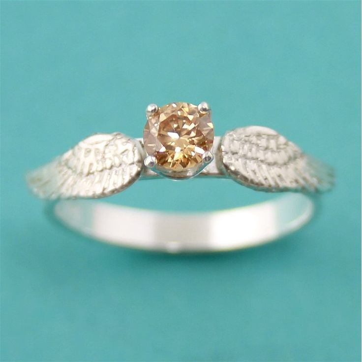 Golden snitch engagement ring