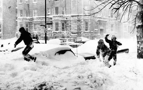 Youths in the middle of a snowball fight, Blizzard of 1967, Chicago.