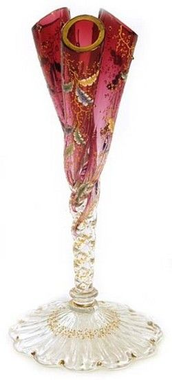 A Moser vase having a scalloped shell-form crystal foot, twist stem standard and cranberry triple prong bud vase body, decorated with fall leaves and gold prunts. Czechoslovakia, circa 1893-2006