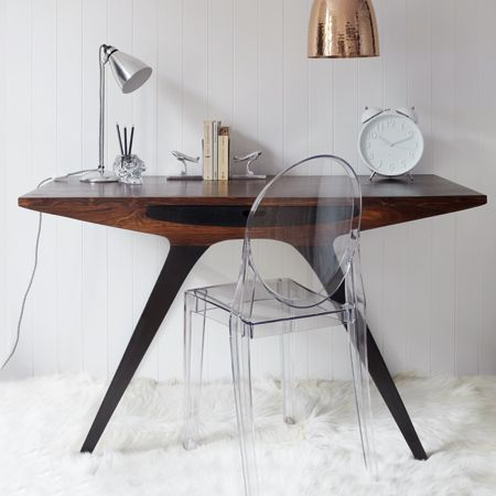 Odyssey Writing Desk Based on an Italian 1940's design, this stunning writing desk would be entirely comfortable in both traditional and modern interiors. With a single storage drawer in the centre and finished in a dark oak wood stain, working from ho