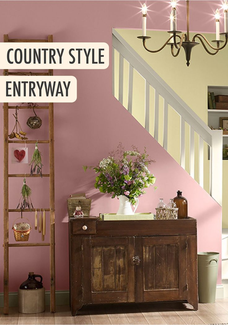 Give Your Foyer A Feminine Country Feel With Light Pink BEHR Paint Color And Vintage Industrial Furniture To Tie The Look Together