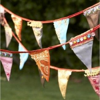 Bollywood-party-bunting-from-the-Wedding -- maybe not exactly this, but i like the idea for bunting that matches the theme for extra decoration.