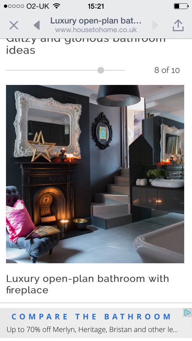 Black open plan bathroom with fireplace