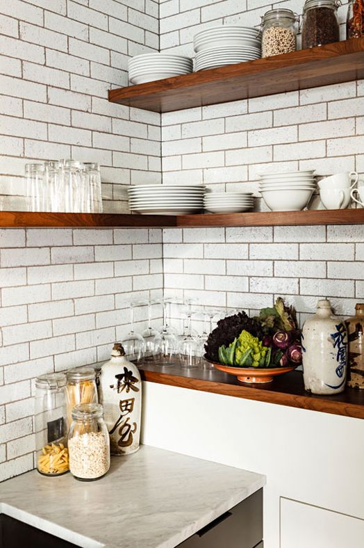 Subway tiles, walnut shelves + marble