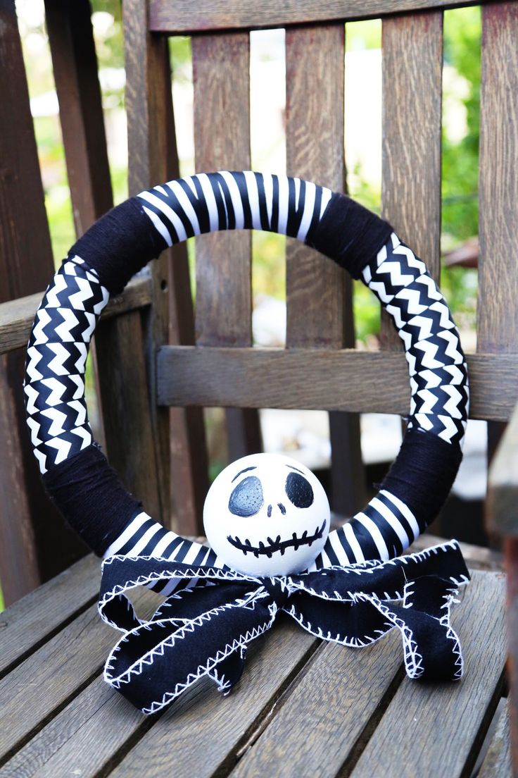 """Won't ya please make way for a very special guy? Our man, Jack, is King of the Pumpkin patch."" Inspired by Tim Burton's The Nightmare Before Christmas, this DIY Jack wreath craft can be made from ribbons, styrofoam, yarn, paint, hot glue and our printable template."