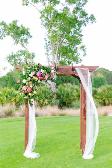 Wooden Arch Arbor with Florals and Draping | Turquoise + Gold Daniel Island Club Wedding by Charleston wedding photographer Dana Cubbage