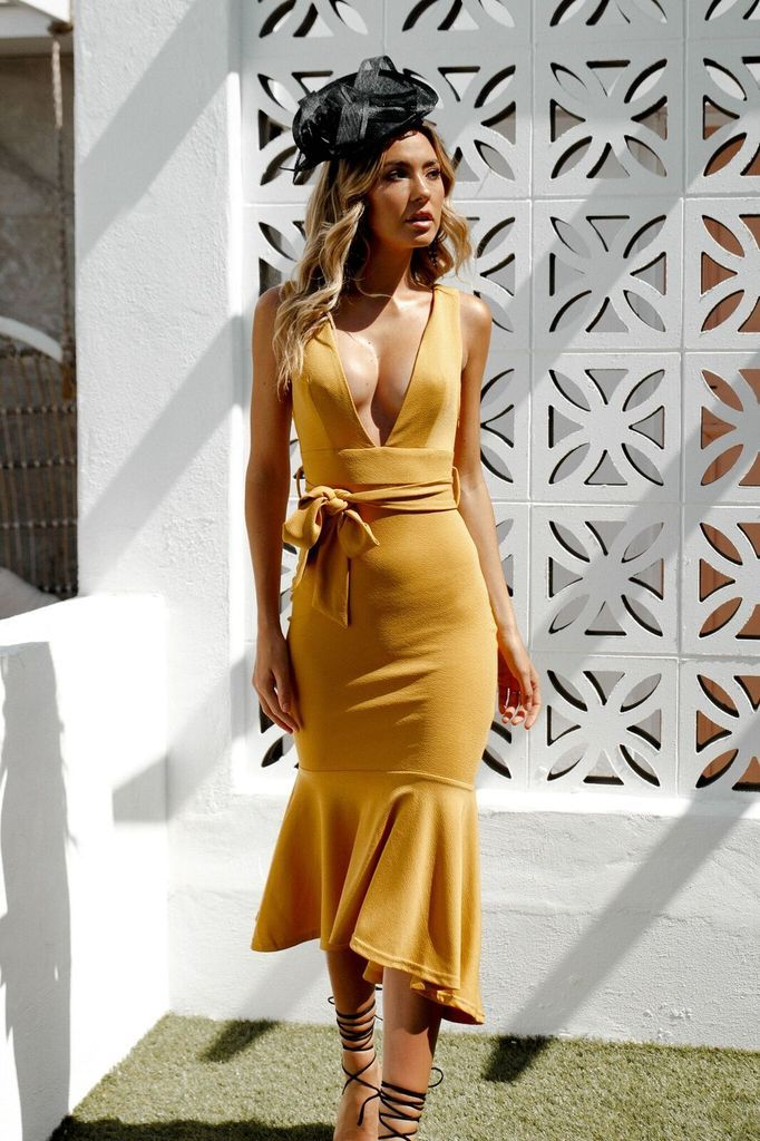 Royale Dress - Mustard! The perfect stretch crepe dress with V neck and fishtail  hem detail! Shop now from Nouveau Riche Boutique Semi Formal Dresses! 639b13d96