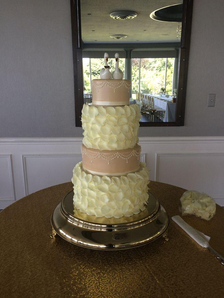 beige/nude wedding cake with ivory petals