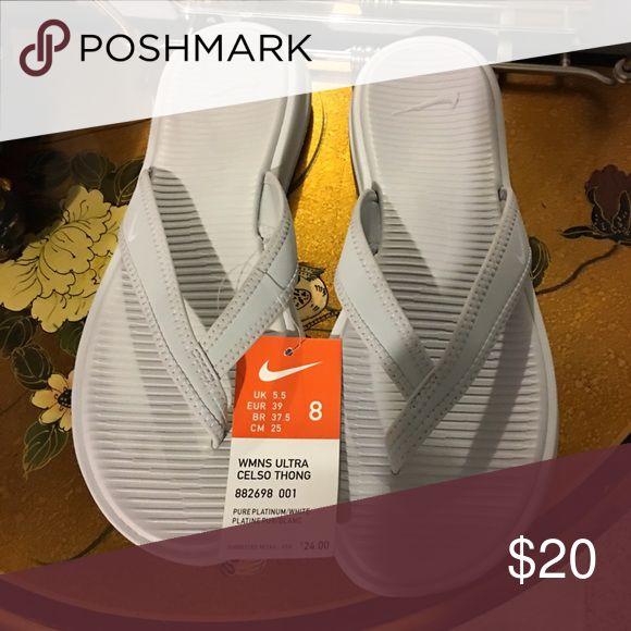 Nike flip flops size 8. NWT