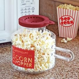 I want one! Glass Microwave Corn Popper. You can add butter to the lid so it melts over the popcorn. No oil, no salt.