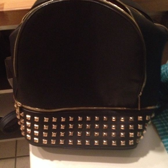 """Brand new studded glamorous book bag very roomy. Brand new studded glamorous book bag very roomy.It has 4 large compartments pockets. Great to go out on the town for students to the beach or just for the statement. Looks like the Michael Kross book bag .12.5"""" Length  11"""" Width 6"""" Depth Bags Backpacks"""