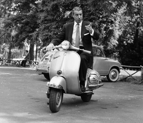 Joe DiMaggio rides a scooter in Rome, June 1957.