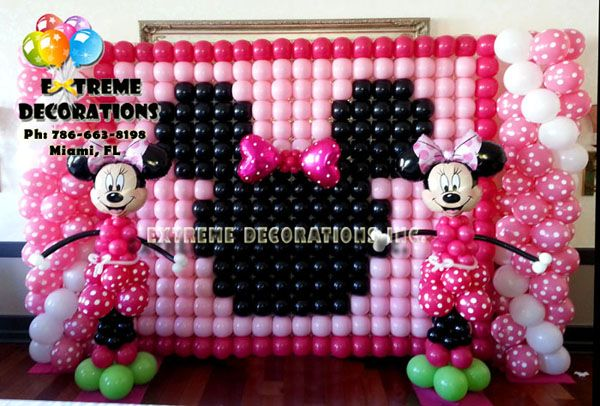 Kids Party Decorations - Minnie Mouse Balloon wall. Pink Minnie balloon sculptures. Polka dot. Minnie mouse party decoration ideas. Ph: 786-663-8198