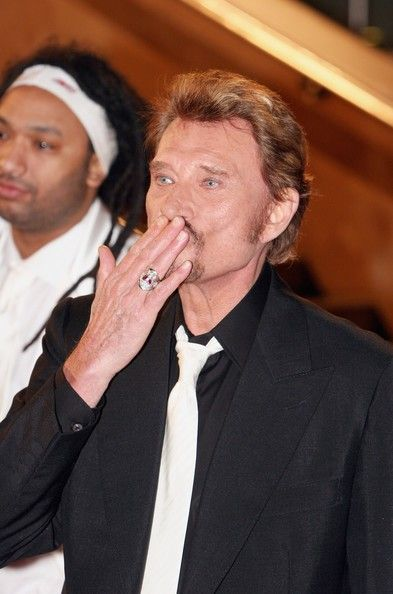 Johnny Hallyday Photos - Johnny Hallyday arrives at the NRJ Music Awards 2006 at the Palais des Festivals on January 21, 2006 in Cannes, France. The annual awards recognize the best French and international artists of 2005 and it is a precursor to the Midem, The World's Music Market. - NRJ Music Awards