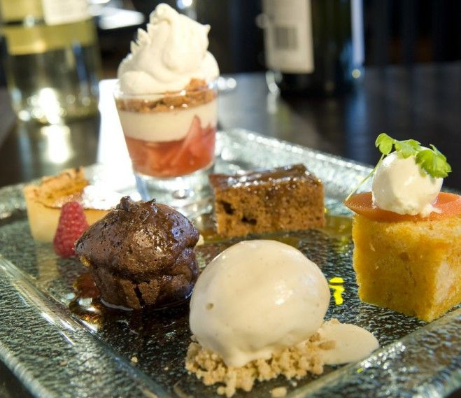 Assiette of desserts, on of our most popular desserts on the menu. A little piece of every dessert on our menu.