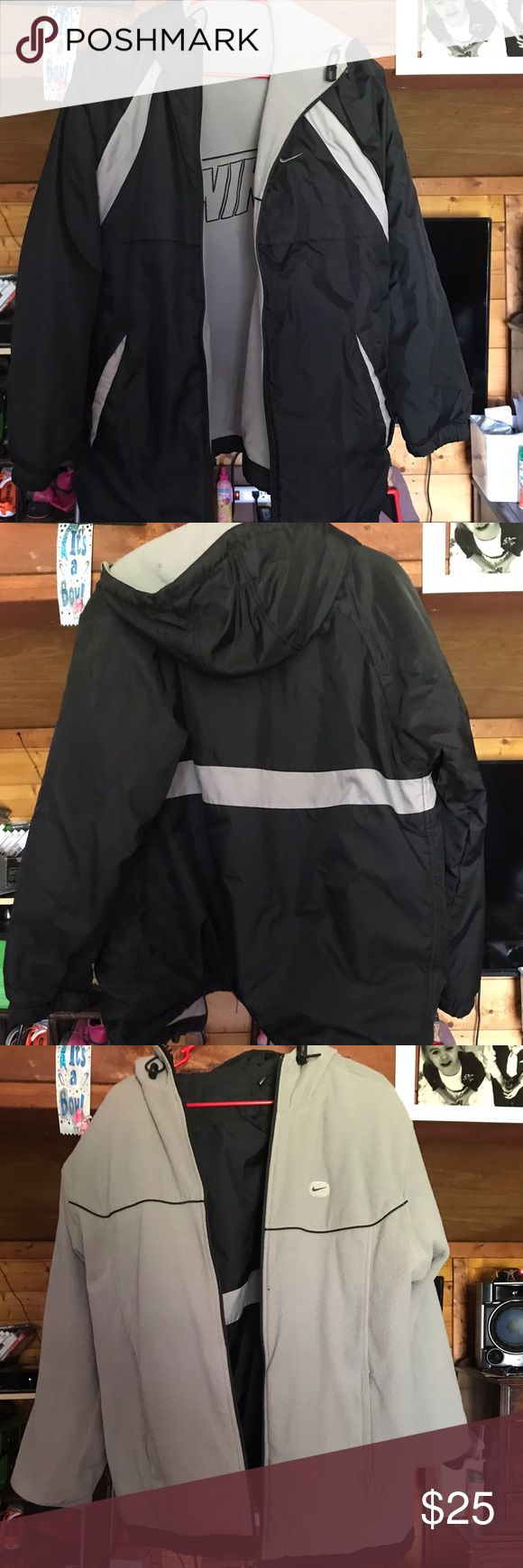Nike Coat This is a men's size small (fits like a large in women's) black and gray Nike coat. It's very warm and in great shape. Nike Jackets & Coats