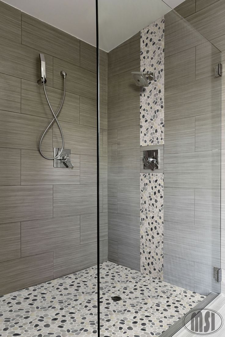 Coordinating Bathroom Floor And Wall Tile : Love the pebble glass waterfall vertical design and