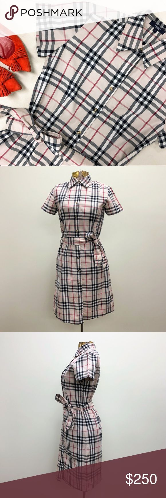 """Authentic Burberry printed shirt dress Burberry puts its signature stamp on the classic shirt dress, covering this effortlessly polished style with the iconic plaid print, and adding an optional sash belt for figure-flattering definition. * Point collar, short sleeves * Detached sash belt * allover signature check print * Fits SMALL * Approx. 37"""" from back of neck to hem * Shoulders 16"""" * Bust 36"""" * Waist 33"""" * Hips 39"""" Burberry Dresses Mini"""