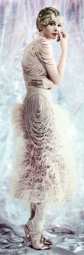 The Great Gatsby Vintage Fashion - Vogue - Alexander McQueen ostrich feather dress with chiffon-covered pearls