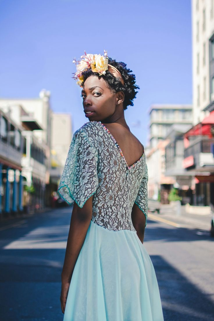 Cotton word printed front with back lace and chiffon skirt. Credits:  Model: Nandipha Gumede. Photographer: Tina Hsu. Location: Greenmarket Square, Cape Town, South Africa