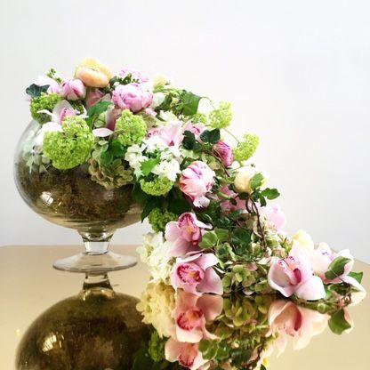 Cascading arrangement #orchids #peonies #ivy