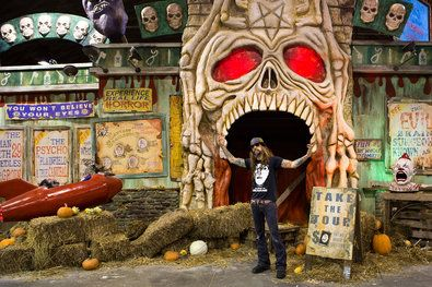 """Rob Zombie poses in front of House of 1,000 Corpses, one of the three """"sick, twisted"""" haunted houses based on his movies that are part of  his Great American Nightmare"""
