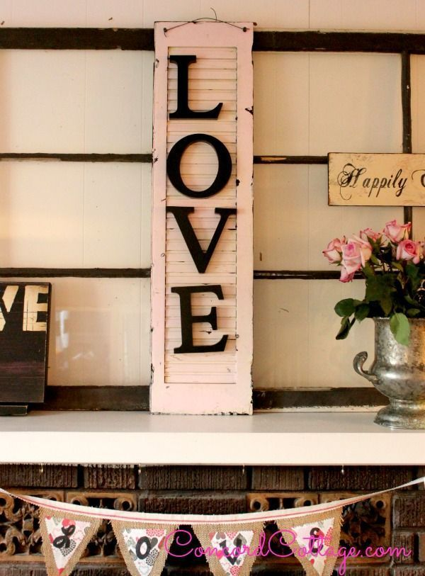 Turn an old shutter into a piece of Valentine's Day art for your mantel with this repurposed DIY.