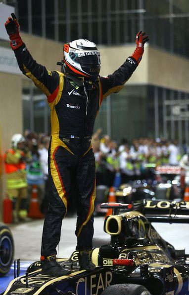 Kimi Raikkonen of Finland and Lotus celebrates in parc ferme after winning the Abu Dhabi Formula One Grand Prix