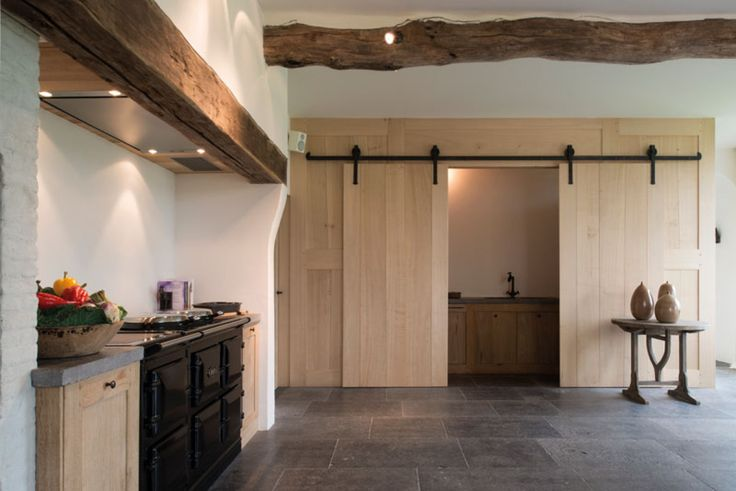lots of bare wood, beams, dark hardware, grey stone flooring, simple  Home Sweet Home »A Kempen farm, restored with soul and passion