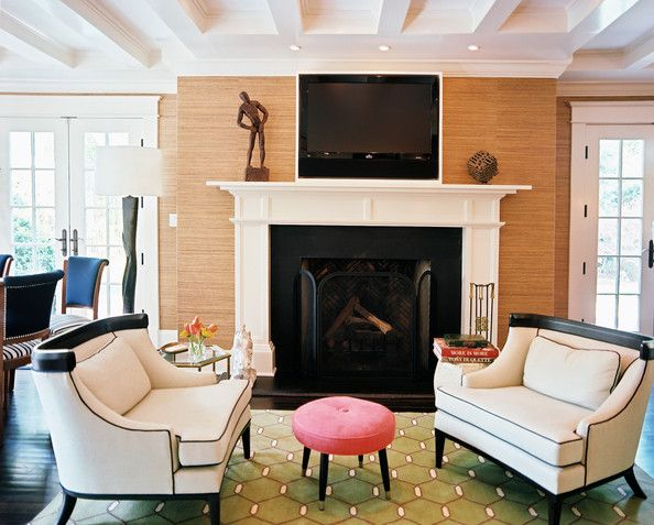 Living Room Photo - A pair of settees and a pink stool atop a green rug