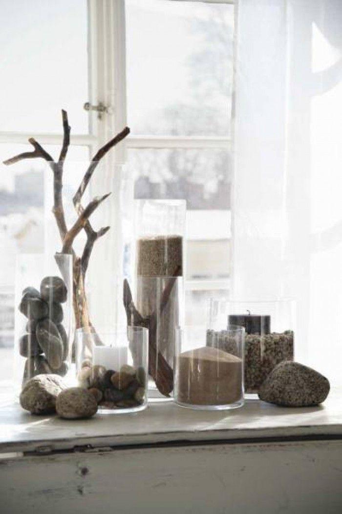 Mooi en decoratief: takken in hoge glazen vazen