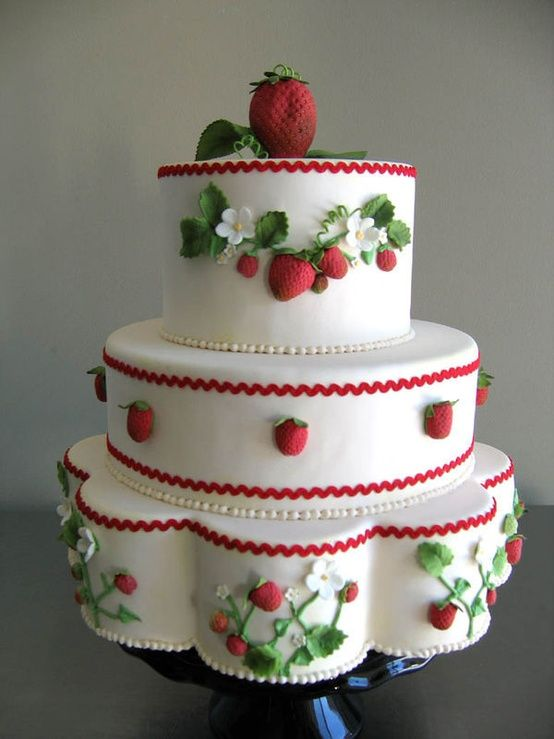 Strawberries on a beautiful cake.  |  Style Me Pretty