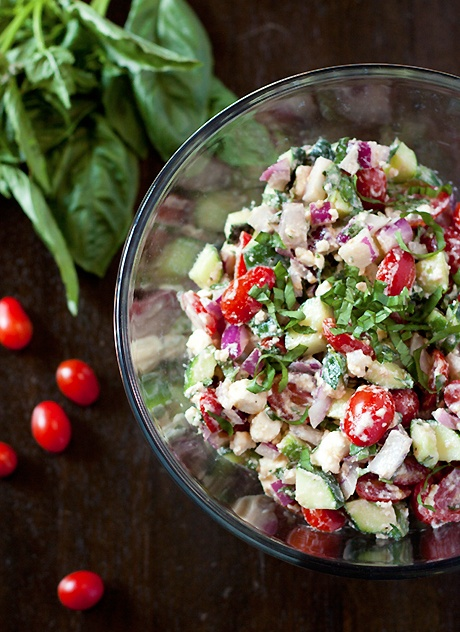 My family is going to go crazy when they tast this cucumber tomato feta salad! It's so refreshing and will add bright color to you Easter lunch or dinner table | local kitchen blog