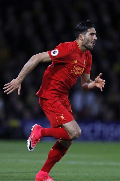 Liverpool's German midfielder Emre Can celebrates after scoring the opening goal of the English Premier League football match between Watford and Liverpool at Vicarage Road Stadium in Watford, north of London on May 1, 2017. / AFP PHOTO / Adrian DENNIS / RESTRICTED TO EDITORIAL USE. No use with unauthorized audio, video, data, fixture lists, club/league logos or 'live' services. Online in-match use limited to 75 images, no video emulation. No use in betting, games or single…
