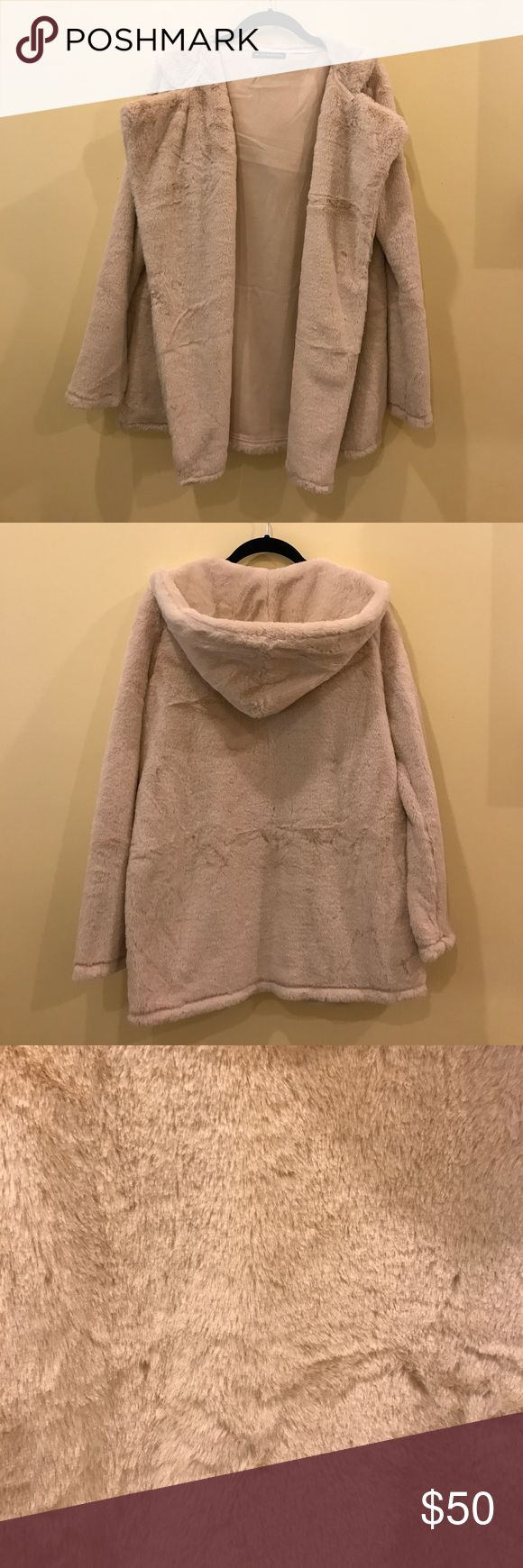 "Brandy Melville Faux Fur Hooded Coat No closure cream color faux fur hooded coat from Brandy Melville. *Never worn. *No size tag. *Approximate measurements: shoulder to shoulder: 17"", length: 28"", sleeve length: 25"". Brandy Melville Jackets & Coats"